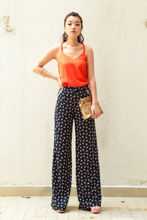 Aijek Coral Top matched with a gorgeous Palazzo pants. Completed with Edge of Ember earrings and bangles and a laser cut gold Marie Turnor picnic clutch.