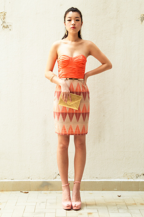 Aijek Pentip bustier dress with a gold Heirloom envelope clutch and tonnes of gold accessories from Edge of Ember.