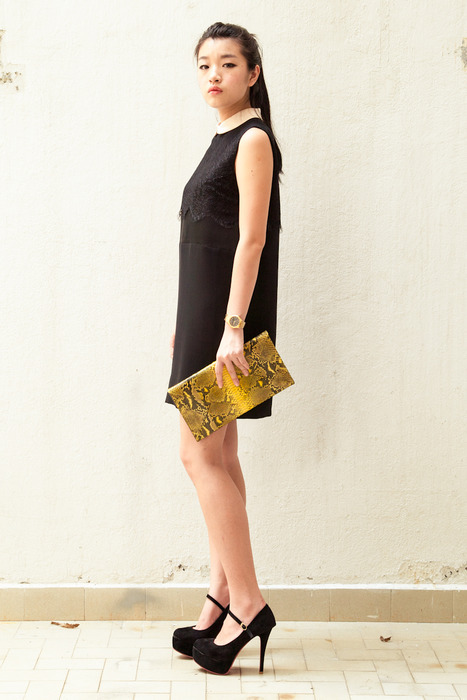 DEBB black lace dress as seen with a Tezzo bright yellow python clutch.